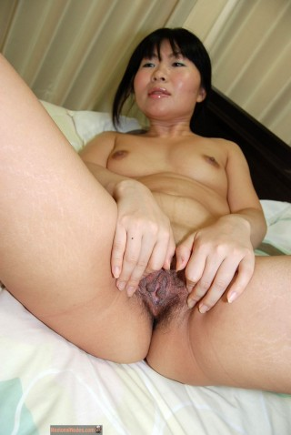 Nude Japanese Lady Spreading Pussy