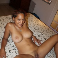 Busty Naked Dominican Gal Legs Open