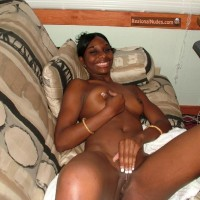 Smiling Nude Ugandan Woman on Couch