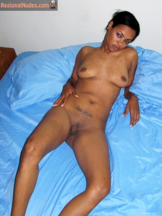 Nude Dominican Slut Laying in Bed