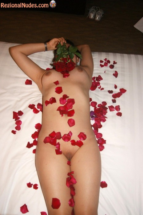 Romantic Naked Singaporean Teen Covered with Rose Petals