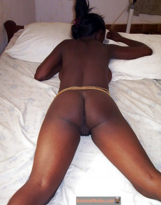 Nigerian Female Naked in Bed Face Down