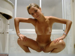 Nude Spanish Girl Squatting in Bathroom