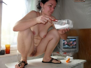 Nude Bulgarian Woman Squatting and Eating