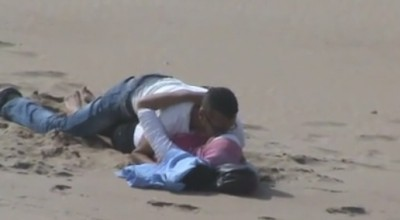 Spying Moroccan Couple Touching on Beach