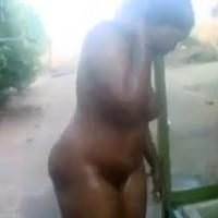 Sudanese Woman Washing Outside