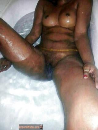Nude Burundian Girl Taking a Bath