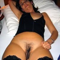 Italian Mother Exposing Unshaven Pussy in bed