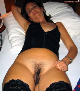 Italian Mother Exposing Unshaven Pussy in bed