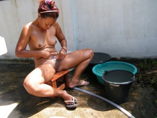 Nudist Thai Wife Shaving in the Yard