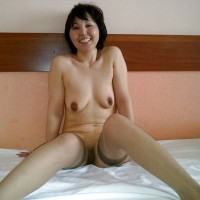 Happy Mongolian Young Woman Nude in Bed
