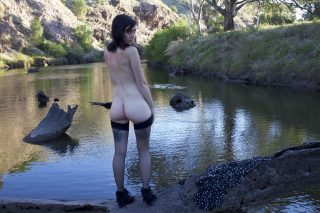 girl-undressing-butt-at-the-lake-in-portugal
