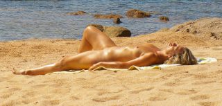 Mature French Nudist Woman on Beach